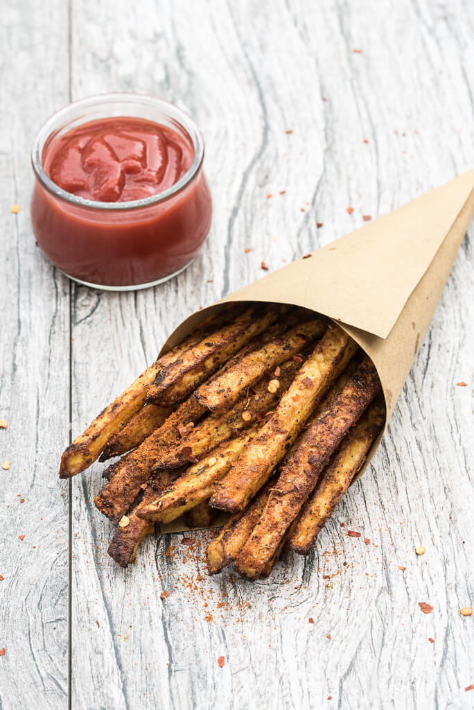 Baked Cajun Fries Recipe - Crispy, oven baked, spicy french fries! - VeganFamilyRecipes.com #healthy #potatoes #vegan